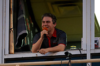 Lansing Lugnuts broadcaster Jesse Goldberg-Strasser leads the 7th Inning Stretch during a Midwest League game against the Burlington Bees on July 18, 2019 at Cooley Law School Stadium in Lansing, Michigan.  Lansing defeated Burlington 5-4.  (Mike Janes/Four Seam Images)