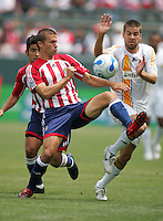 Chivas USA MID Jesse Marsch (15) battles LA Galaxy MID Kyle Martino (18) for a ball. LA Galaxy played the Chivas USA to a 1-1 draw at the Home Depot Center in Carson, California, May 20, 2007.