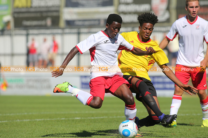 Ivan Nsimbi of Woking takes a shot at goal as Watford's Joy Mukena tries to block the ball during Woking vs Watford, Friendly Match Football at The Laithwaite Community Stadium on 8th July 2017