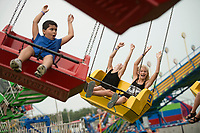 NWA Democrat-Gazette/BEN GOFF @NWABENGOFF<br /> Lauren Williams (left), 13, and Caroline Costantini, 11, of Bentonville take a spin on the 'Whirlwind' ride Saturday, Aug. 12, 2017, on the final day of the Benton County Fair in Bentonville.