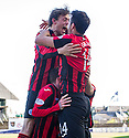 St Johnstone's Murray Davidson and  Brian Graham squash Danny Swanson as they celebrate him scoring their first goal.