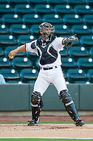 Winston-Salem Dash catcher Kevan Smith (24) throws the ball back to his pitcher during the Carolina League game against the Salem Red Sox at BB&T Ballpark on August 15, 2013 in Winston-Salem, North Carolina.  The Red Sox defeated the Dash 2-1.  (Brian Westerholt/Four Seam Images)
