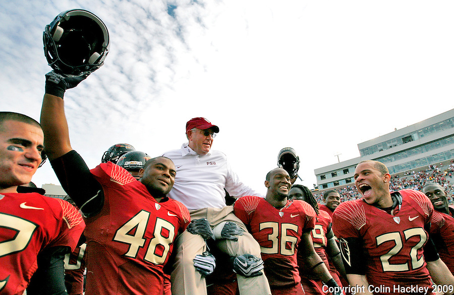 TALLAHASSEE, FL 11/21/09-FSU-MARY FB09 CH80-Florida State's Recardo Wright, left, and Dekoda Watson carry Defensive Coordinator Mickey Andrews off the field at the close of his final game at Doak Campbell Stadium, Saturday in Tallahassee. The Seminoles beat the Maryland Terrapins 29-26..COLIN HACKLEY PHOTO