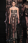 "Model walks runway in a re-embroidered black lace column dress over nude lace underpinning from the Reem Acra Fall 2016 ""The Secret World of The Femme Fatale"" collection, at NYFW: The Shows Fall 2016, during New York Fashion Week Fall 2016."