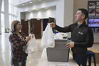 """Lead Pastor Mark Snodgrass (right) hands bags of toilet paper to Carlinda Pacheco of Bentonville (left), Monday, March 16, 2020 at the Bentonville Community Church in Bentonville. Pacheco, a member of SOCO Church, spent the day picking up bags to distribute to people at her own church. She said she was motivated to do this after seeing empty shelves at 19 different stores she visited in search of toilet paper. """"My husband says I'm the toilet paper dealer,"""" she said jokingly. Check out nwaonline.com/200317Daily/ for todayÕs photo gallery.<br />(NWA Democrat-Gazette/Charlie Kaijo)<br /><br />Lead Pastor Mark Snodgrass donated rolls of church surplus toilet paper after finding the shelves empty over the weekend following recent updates on the coronavirus.<br /><br />""""I remembered we had gotten a shipment of toilet paper. It's not gonna do us any good sitting in a closet, he said adding that the church had moved it Sunday services online.<br /><br />He said several people had stopped by to pick up some rolls and one person even picked up rolls to distribute to others at another church. In addition, he said as many people stopped by to donate rolls.<br /><br />""""People have donated about 100 rolls today. I've almost received as much as I've donated,"""" he said. """"We're a church and we believe this kingdom that christ invites us to is a kingdom of abundance. When we give we find he continues to give and bless us. We want to model that for our community. We're gonna get through this."""""""