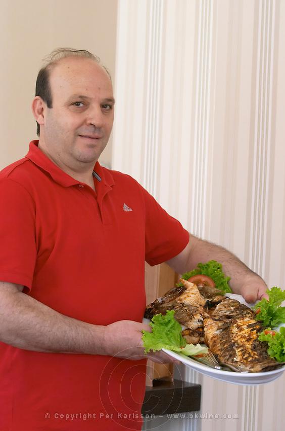 The chef presenting the grilled fish. Wine Art Estate Winery, Microchori, Drama, Macedonia, Greece