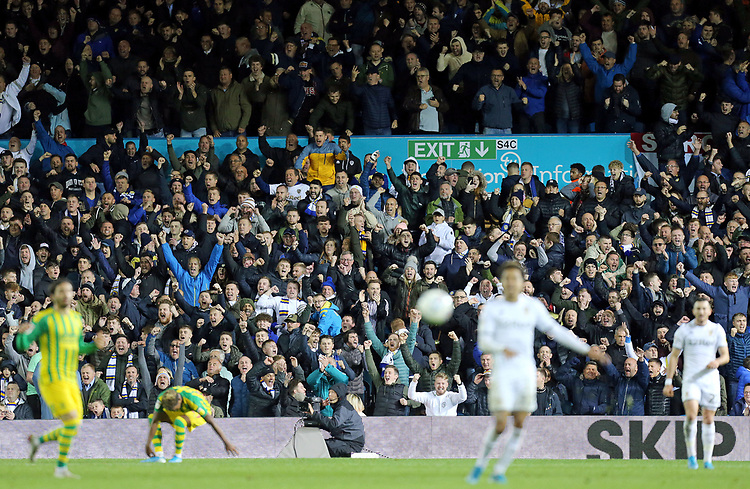 Leeds United fans celebrate victory at the final whistle<br /> <br /> Photographer Rich Linley/CameraSport<br /> <br /> The EFL Sky Bet Championship - Tuesday 1st October 2019  - Leeds United v West Bromwich Albion - Elland Road - Leeds<br /> <br /> World Copyright © 2019 CameraSport. All rights reserved. 43 Linden Ave. Countesthorpe. Leicester. England. LE8 5PG - Tel: +44 (0) 116 277 4147 - admin@camerasport.com - www.camerasport.com