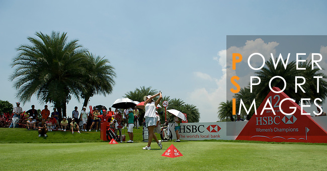 SINGAPORE - MARCH 08:  Jane Park of the USA tees of on the par four 12th hole during the final round of HSBC Women's Champions at the Tanah Merah Country Club on March 8, 2009 in Singapore.  Photo by Victor Fraile / The Power of Sport Images