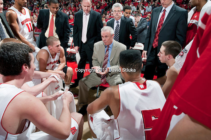 Wisconsin Badgers Head Coach Bo Ryan talks to his team during an NCAA college basketball game against the Savannah State Tigers on December 15, 2011 in Madison, Wisconsin. The Badgers won 66-33. (Photo by David Stluka)