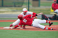 Chris DelDebbio (10) of the Hartford Hawks is tagged out by Cornell Big Red third baseman Trey Baur (35) at The Ripken Experience on February 28, 2015 in Myrtle Beach, South Carolina.  The Big Red defeated the Hawks 4-3.  (Brian Westerholt/Four Seam Images)