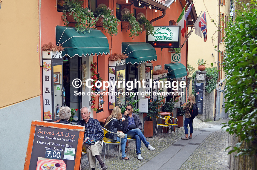 Al fresco dining, narrow street, Bellagio, Lake Como, Italy, 4th October 2014, 201410043649<br />