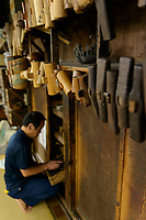 Tools ready for use in the workshop of Gyokusendo, Tsubame, Niigata Pref, Japan, August 24, 2017. Traditional copper metalworking company Gyokusendo was founded in 1816 and is a registered as a traditional craft of Japan. At Gyokusendo, in a highly-skilled craft process, complex items such as teapots are beaten from a single sheet of copper using hammers and hundreds of other specialist tools.