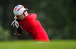 Mi-Hyang Lee of Korea plays a shot during the Hyundai China Ladies Open 2014 on December 10 2014 at Mission Hills Shenzhen, in Shenzhen, China. Photo by Xaume Olleros / Power Sport Images