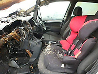 Pictured: The burned out Vauxhall Zafira, owned by Jason Williams of Swansea, Wales, UK. <br /> Re: Jason Williams from Swansea has sued car manufacturer Vauxhall after the silver Zafira he owned, burst into flames trapping him and his three year old daughter inside. As a result, his right hand was injured while he was trying to smash the windscreen in order to free himself during the incident in south Wales, UK.