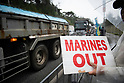 Anti US Base protesters rally outside US Base Camp in Okinawa