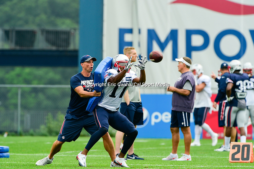 August 3, 2017: New England Patriots wide receivers coach Chad O'Shea hits wide receiver Tony Washington (17) with a cushion while he is making a catch at the New England Patriots training camp held at Gillette Stadium, in Foxborough, Massachusetts. Eric Canha/CSM
