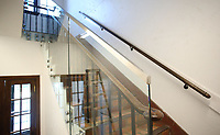 NWA Democrat-Gazette/DAVID GOTTSCHALK  Original restored banisters Tuesday, July 25, 2017, are paired with glass railings  at the new Haas Hall Academy Rogers Campus in Rogers. The campus is in the former historic Lane Hotel in the Rogers Commercial Historic District.