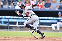 Rome Braves right fielder Israel Wilson (20) lays down a bunt during a game against the Asheville Tourists at McCormick Field on July 27, 2017 in Asheville, North Carolina. The Braves defeated the Tourists 6-3. (Tony Farlow/Four Seam Images)