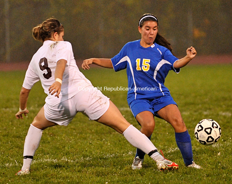 NAUGATUCK, CT - 03 October 2012-100312EC10--    Naugatuck's Steph Lima knocks the ball out of Seymour's Alyssa Brana's control.  The Greyhounds won Wednesday night, 5-1.  Erin Covey Republican-American.