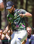 Steph Curry reacts after singing a putt during the ACC Golf Tournament at Edgewood Tahoe Golf Course in South Lake Tahoe on Sunday, July 14, 2019.