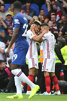 Callum Robinson and George Baldock celebrate Sheffield United's second goal during Chelsea vs Sheffield United, Premier League Football at Stamford Bridge on 31st August 2019