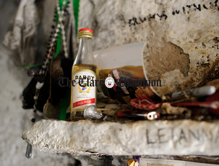 "A ""drop of the hot stuff"" left perhaps for a loved one that passed away, during the annual celebration at St Bridget's Well. Photograph by John Kelly."