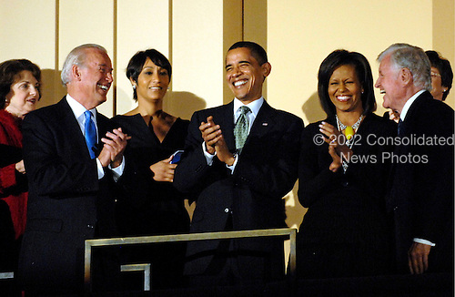 Washington, DC - March 8, 2009 -- United States Vice President Joe Biden (L), U.S. President Barack Obama  and first lady Michelle Obama (C) join Senator Ted Kennedy (Democrat- Massachusetts) (R)  at a musical tribute to celebrate Kennedy's birthday at the Kennedy Center in Washington, DC., USA, on Sunday, 08 March 2009. .Credit: Chris Usher - Pool via CNP