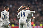 Carlos Henrique Casemiro, Marcelo Vieira Da Silva, and James Rodriguez celebrate during the match Real Madrid vs Napoli, part of the 2016-17 UEFA Champions League Round of 16 at the Santiago Bernabeu Stadium on 15 February 2017 in Madrid, Spain. Photo by Diego Gonzalez Souto / Power Sport Images