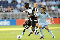 Newcastle United midfielder Chiek Tiote ( black & white) goes past Graham Zusi Sporting KC... Sporting Kansas City and Newcastle United played to a 0-0 tie in an international friendly at LIVESTRONG Sporting Park, Kansas City, Kansas.