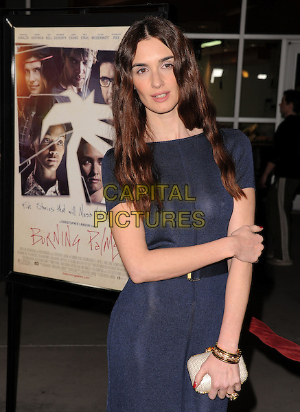 "PAZ VEGA.attending the New Films Cinema's Premiere of ""Burning Palms"" held at The Arclight Theatre in Hollywood, California, USA, January 12th 2011..half length dress arm holding bracelets  navy blue gold clutch bag white cream  .CAP/RKE/DVS.©DVS/RockinExposures/Capital Pictures."