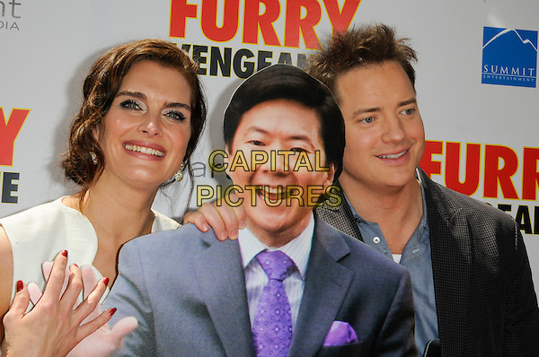 "BROOKE SHIELDS, KEN JEONG  (cutout) & BRENDAN FRASER .The Los Angeles premiere of ""Furry Vengeance"" at Mann Bruin Theatre in Westwood, California, USA..April 18th, 2010 .half length white sleeveless grey gray blue suit jacket check shirt red nail varnish bracelet dress smiling headshot portrait .CAP/ROT.©Lee Roth/Capital Pictures"