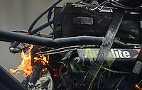 Oct. 6, 2012; Mohnton, PA, USA: Detailed view of fire and oil from the engine of NHRA top fuel dragster driver Spencer Massey after having an explosion during qualifying for the Auto Plus Nationals at Maple Grove Raceway. Mandatory Credit: Mark J. Rebilas-