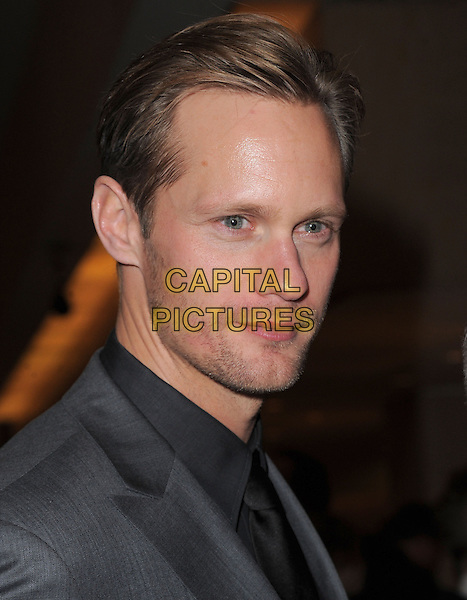 Alexander Skarsgard .Exiting The 70th Annual Golden Globe Awards held at The Beverly Hilton Hotel in Beverly Hills, California, USA..January 13th, 2013.globes headshot portrait black stubble facial hair .CAP/DVS.©DVS/Capital Pictures.