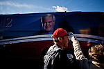 Anneliese Prosser, right, waves as GOP presidential candidate Newt Gingrich departs a campaign event at Great Basin Brewing Company in Reno, Nevada, February 1, 2012.