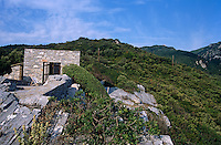 The simple box-like structure is built of stone and perches on a rugged hillside at the foot of Mount Pelion