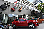 July 27, 2016, Tokyo, Japan - Latest models of Mitsubishi Motors are displayed at its head office in Tokyo on Wednesday, July 27, 2016. The Japanese automaker reported a 75 percent drop in first-quarter operating profit as domestic sales of mini-vehicles plunged in the wake of the companys fuel efficiency data scandal. (Photo by Natsuki Sakai/AFLO) AYF -mis-