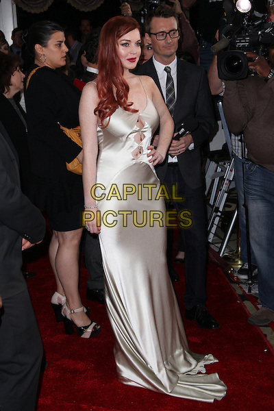 "Lindsay Lohan.Lifetime presents ""Liz & Dick"" - Los Angeles Premiere Held At Beverly Hills Hotel, Beverly Hills, California, USA..November 20th, 2012.full length dress cut out away dyed red hair lipstick silk satin white cream  hand on hip.CAP/ADM/KB.©Kevan Brooks/AdMedia/Capital Pictures."