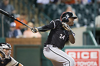 KJ Woods (24) of the Kannapolis Intimidators follows through on his swing against the Greensboro Grasshoppers at NewBridge Bank Park on July 7, 2016 in Greensboro, North Carolina.  The Dash defeated the Pelicans 13-9.  (Brian Westerholt/Four Seam Images)