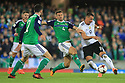 Northern Ireland's Gareth McAuley fails to stop Germany's Sandro Wagner from scoring the second goal during the FIFA World Cup 2018 Qualifying Group C qualifying soccer match between Northern Ireland and Germany at the National Football Stadium at Windsor Park, Belfast, Northern Ireland, 5 Oct 2017. Photo/Paul McErlane