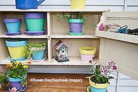 63821-201.06 Potting bench with containers, birdhouse and flowers in spring, Marion Co. IL