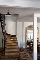 The well-worn wooden treads of the original staircase still graces the entrance hall and dining area