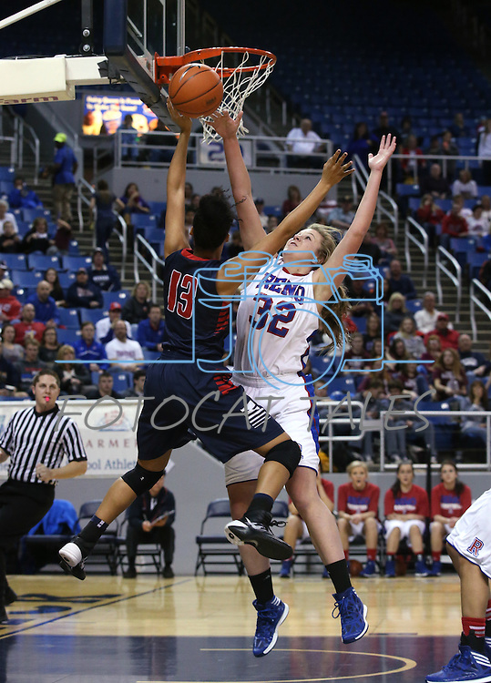 Reno's Morgan McGwire blocks a shot by Liberty's Aubre' Fortner during the Division I championship game in the NIAA basketball state tournament at Lawlor Events Center, in Reno, Nev., on Friday, Feb. 28, 2014. Reno won the state title 50-39. (Cathleen Allison/Las Vegas Review-Journal)