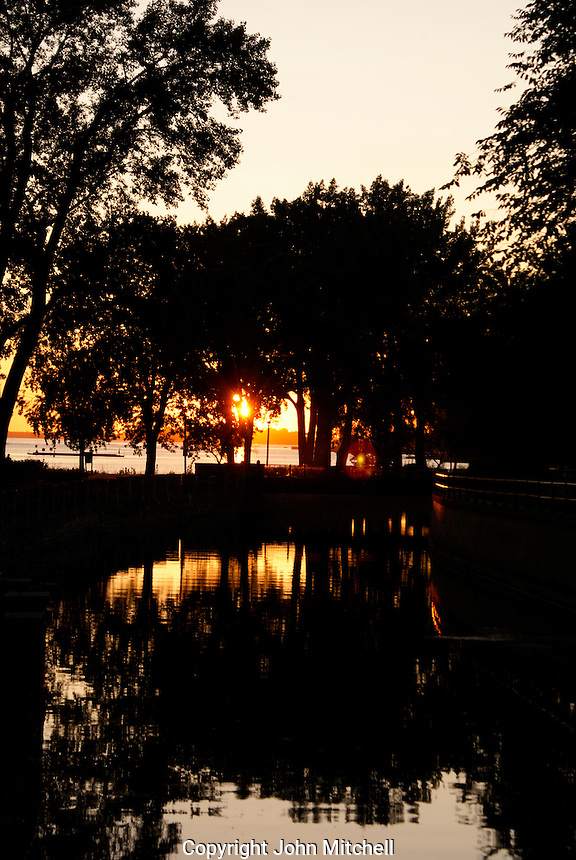 Sun setting over the Saint Lawrence River, Montreal, Quebec, Canada