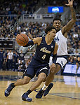 Akron guard Tyler Cheese (4) drives past Nevada forward Jordan Caroline in the second half of an NCAA college basketball game in Reno, Nev., Saturday, Dec. 22, 2018. (AP Photo/Tom R. Smedes)