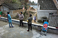 Villagers rest at home in Mingshui Village in Poyang county at Poyang Lake, Jiangxi Province, December 2014. Poyang Lake, located in the north of Jiangxi Province, is the largest freshwater lake in China. It fluctuates dramatically between wet and dry seasons, from 3,500 square kilometres down to about 200 square kilometres. The lake provides a habitat for half a million migratory birds.