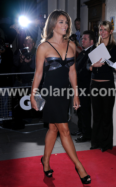 **ALL ROUND PICTURES FROM SOLARPIX.COM**.**WORLDWIDE SYNDICATION RIGHTS**.GQ Awards at the Royal Opera House, Covent Garden.  September 02, 2008..This picture: Liz Hurley.JOB REF:  7182   SSD     DATE: 02.09.08.**MUST CREDIT SOLARPIX.COM OR DOUBLE FEE WILL BE CHARGED* *UNDER NO CIRCUMSTANCES IS THIS IMAGE TO BE REPRODUCED FOR ANY ONLINE EDITION WITHOUT PRIOR PERMISSION*