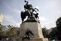 Pictured: A migrant man rests beneath a sculpture in Victoria Square, Athens Monday 29 February 2016<br /> Re: Hundreds of migrants have been living in Victoria Square in central Athens Greece