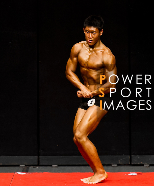 A bodybuilder competes in the Student Athletic Physique category during the 2016 Hong Kong Bodybuilding Championships on 12 June 2016 at Queen Elizabeth Stadium, Hong Kong, China. Photo by Lucas Schifres / Power Sport Images