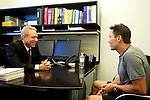 "Dr. Jeffrey Leake, an institute physician in the Las Vegas, Nevada office of Cenegenics, seen April 4, 2011, speaks to patient and fellow doctor Dr. Paul Wilkes, 45. Cenegenics Medical Institute offers aging patients ""age management"" techniques through a thorough medical assessment and hormonal supplements. Dr. Wilkes, who Dr. Leakes has been ""wildly successful"" has been a Cenegenics patient for four years now...(NOTE: Grey shirt is Dr. Wilkes)."