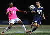 Manhasset No. 6 Kyle Peter, left, gets pressured by Hewlett No. 5 Brian Petterman during a Nassau County varsity boys' soccer game at Manhasset High School on Thursday, October 15, 2015. Manhasset won by a score of 2-0.<br /> <br /> James Escher